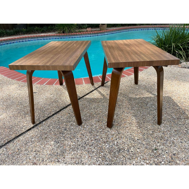 Pair of Thonet bentwood end tables in lovely condition. Laminate wood grain tops, walnut legs. Sturdy tables with all...