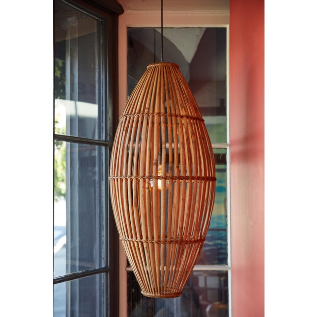 Bent rattan hanging light. Vintage.