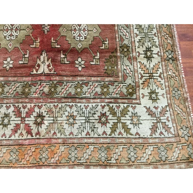 Attractive vintage Turkish Ushak village rug from central west Turkey. The piece was made circa 1920 on red copper field....