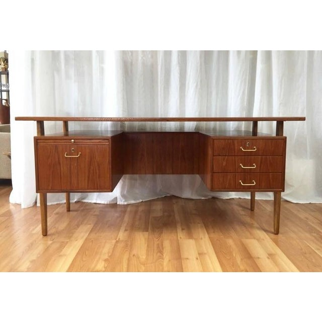A fantastic and expansive Danish modern teak and oak floating top executive desk with drawers by Torben Strandgaard. Teak...