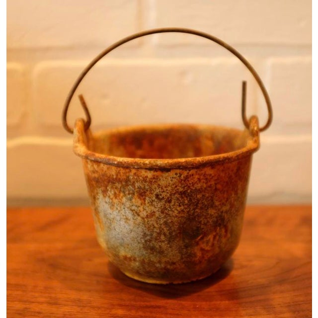 A patinated foundry smelting crucible. A fantastic piece to be used decoratively or as a planter. Bright orange, yellow...