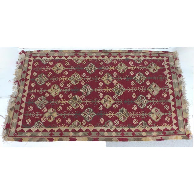 """Offered is a older Kilim rug that measures 7""""8"""" by 5""""3"""". The rug is the same on both side and is generally in good..."""
