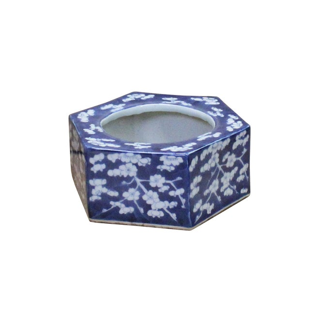 This is a blue & white porcelain hexagon container bowl with blossom flower graphic on the surface. Not for serving....