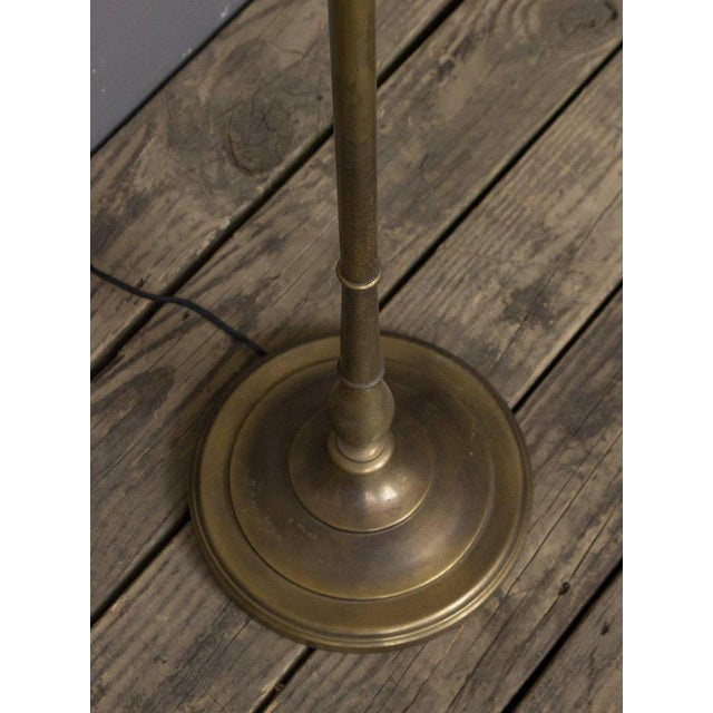 French 1940s floor lamp, recently re-plated in English brass finish. It is wired with double sockets as well as three...
