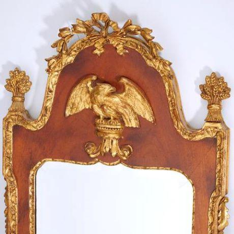 20th c., Decorative Federal-style mirror in mahogany with eagle in relief, ribbon and bellflower crest, wheat sheaf...