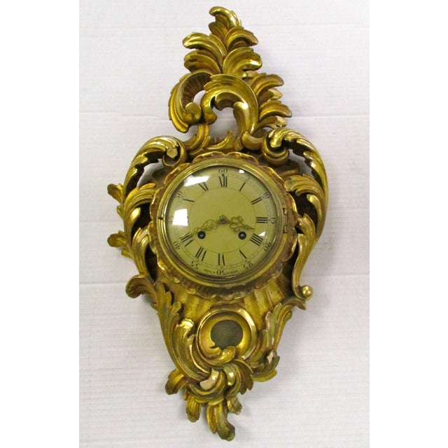 Antique Swedish carved giltwood wall clock in the Rococo style. Not in working condition.