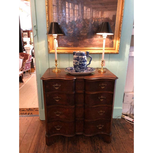 Beautiful serpentine shaped antique mahogany French dresser having 4 drawers and original hardware.