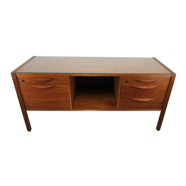 1950's Jens Risom walnut credenza with fitted glass top. Beautiful wood pulls open 5 drawers, one of which is capable of...