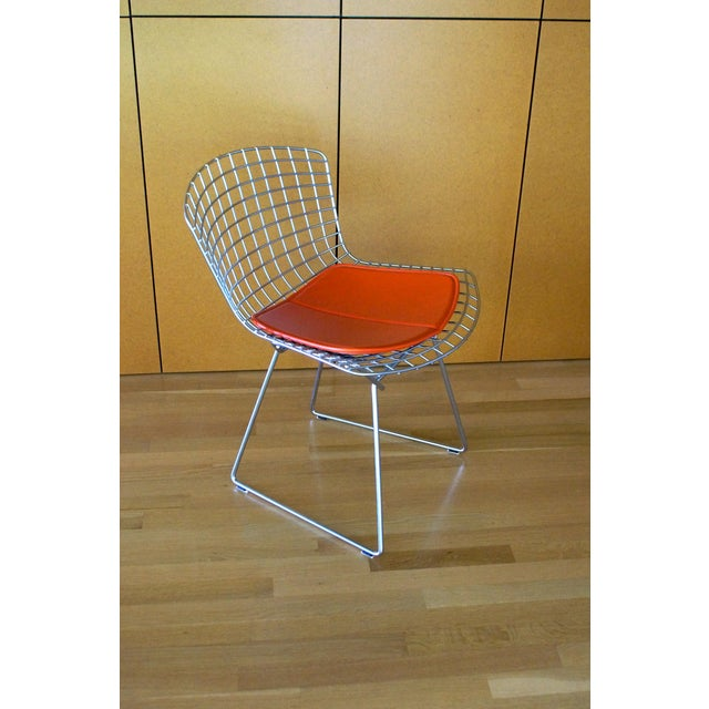 Set of 10 Bertoia side chairs in excellent condition, gently used. Classic satin chrome finish. Includes two sets of...