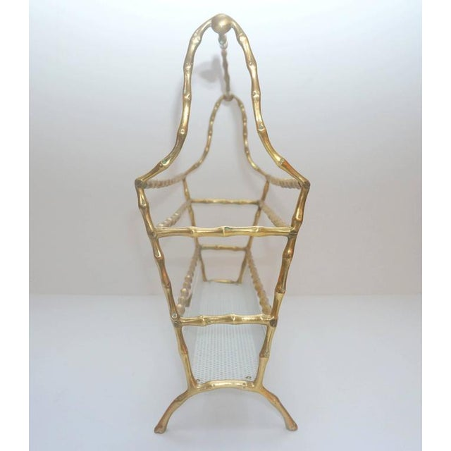 This chic 1960s faux-bamboo magazine holder is fabricated in cast-bronze and enameled metal. The piece is the perfect...