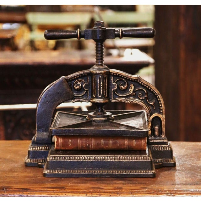 """This beautiful paper binding press was forged in France, circa 1860. The Classic """"Presse a Relier"""" made of solid iron is..."""