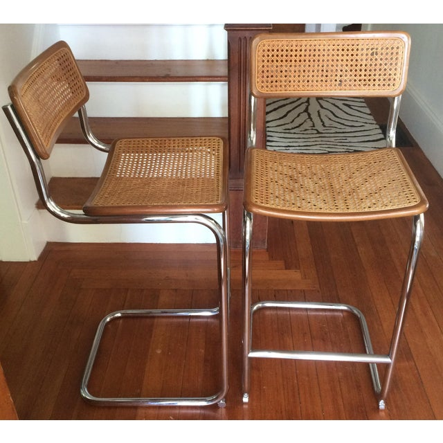 Pair of vintage Cesca style bar stools. They are in great overall condition with minor wear marks on wood. Caned back has...