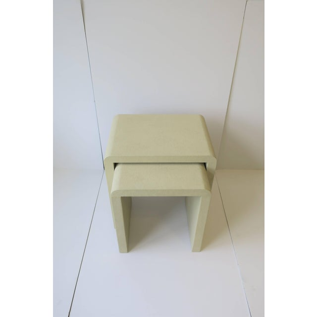 A set of modern shagreen-esque nesting, side or end tables with a 'waterfall' edge in a neutral/taupe hue. Tables measure:...