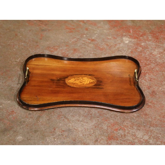 Embellish a coffee table with this elegant antique tray. Crafted in England, circa 1920, the rectangular tray features a...