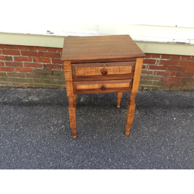 A two drawer stand c1850 with New York state's distinctive square block and turned legs. The stand is made of cherry with...