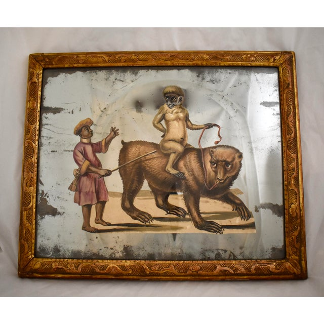 A 19th Century French exotic themed, hand-painted, decoupaged and mirrored depiction of an animal trainer and his monkey...