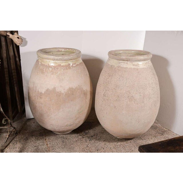 Pair of 19th century Biot jars from France. Priced for the pair, but will sell jars individually at $4,900 each.