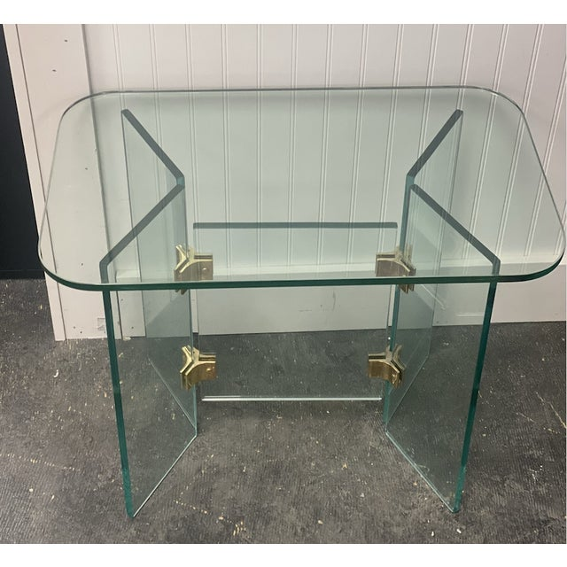 Vintage square side table with bevaled, rounded top glass. The base is formed from thick panels of glass joined by...