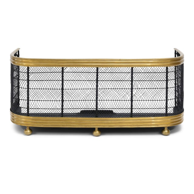 English Regency fire fender (circa 1810-1830) with ribbed brass upper and lower rails, brass feet and interwoven steel...