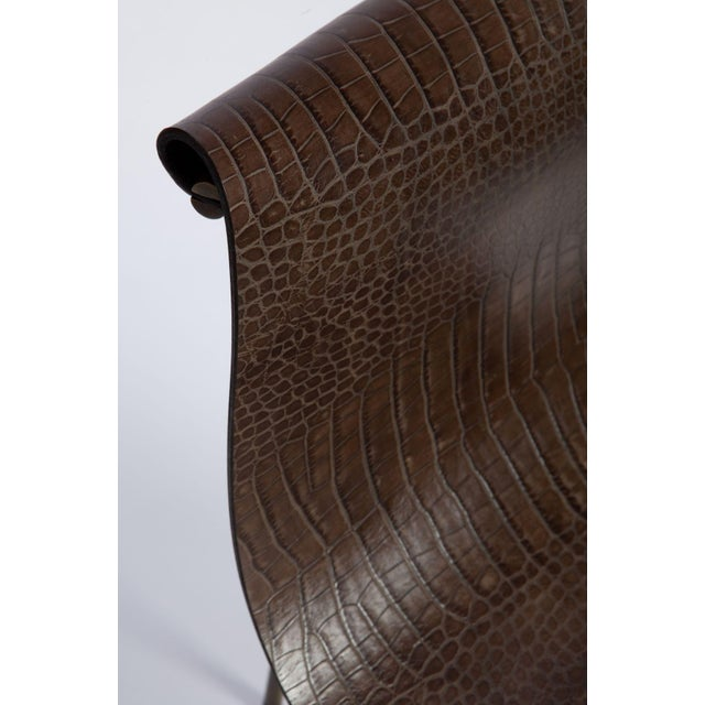 A Mid-century designed chair, crocodile leather with medium antique bronze finish, 1952. Designed by Katavolos Littell and...