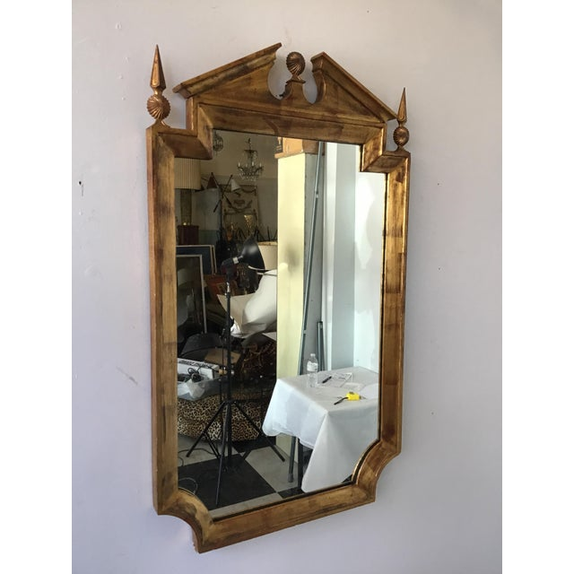 1960s classical giltwood mirror with metal accents by Palladio.