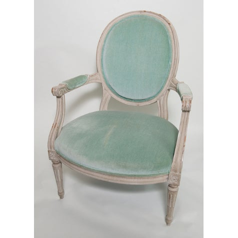 A beautiful vintage French armchair. Painted wood finish with some peeling. Vintage upholstery with some marks; one...