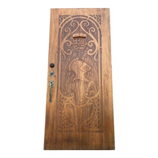 1920s Spanish Style Carved Front Door Featuring a Knights Helm For Sale