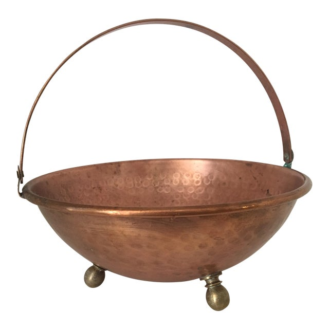 Arts and Crafts Hammered Copper Bowl With Handle and Brass Feet For Sale
