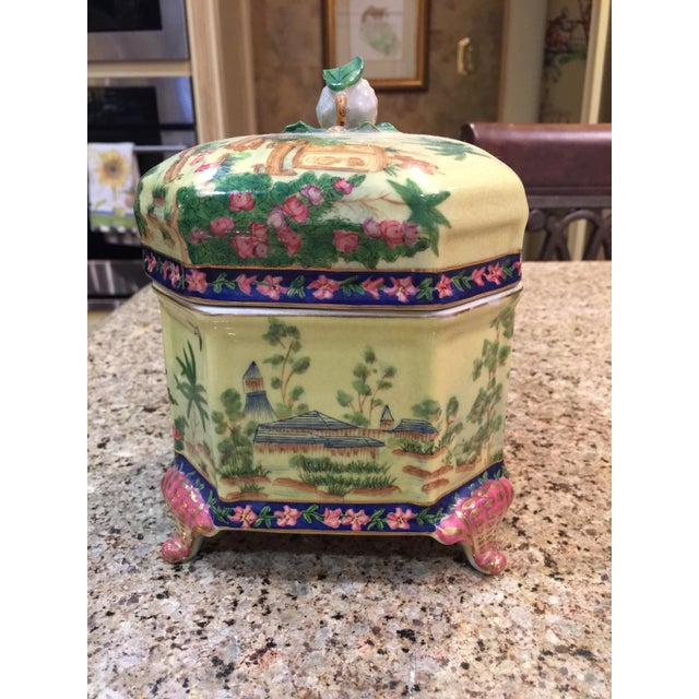This is absolutely one of the prettiest ceramic boxes I have come across. The background color is a lemony yellow with a...
