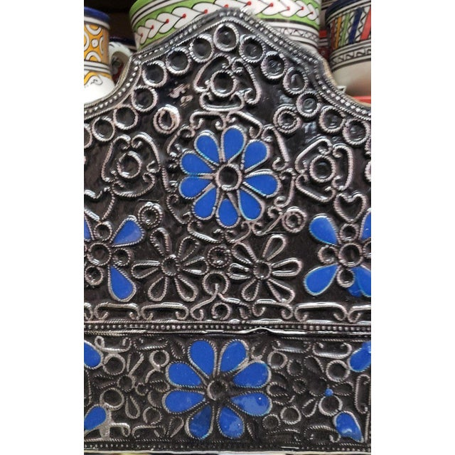 """Medium metal inlaid and Resin Moroccan mirror. Made in the city of Marrakech. Arched shape measuring approximately 24"""" x..."""