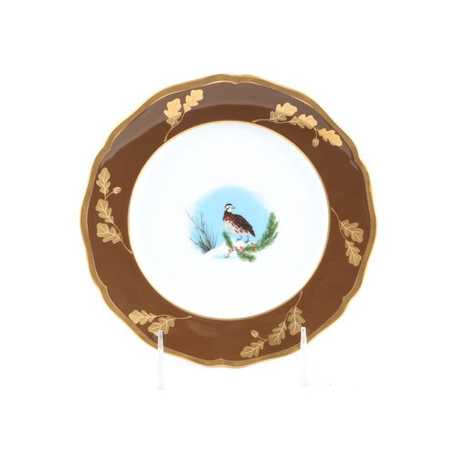 A collection of china tableware from the Winter Game Birds collection in chestnut by Lynn Chase Designs. The china is...