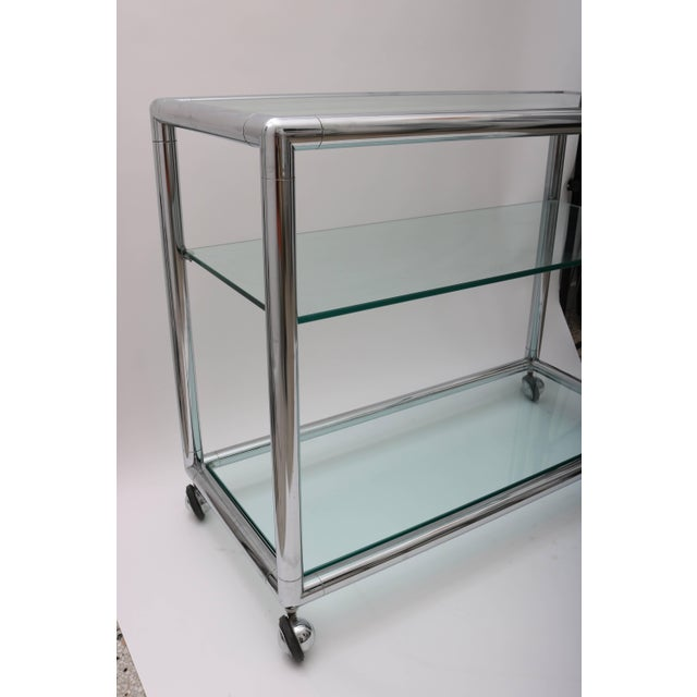 This stylish and clean lined bar cart is very much in the style and quality of pieces created by the Pace Furniture...