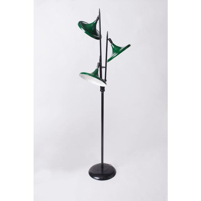 A harmonious and sleek midcentury three-light floor lamp in lacquered metal by Gerald Thurston for Lightolier. With...