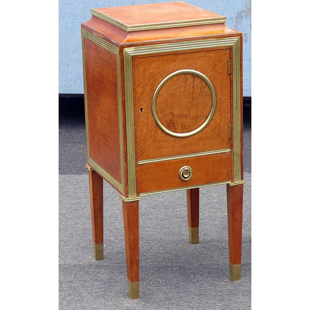 Pair of Russian Baltic style brass mounted nightstands with 1 door over 1 drawer.