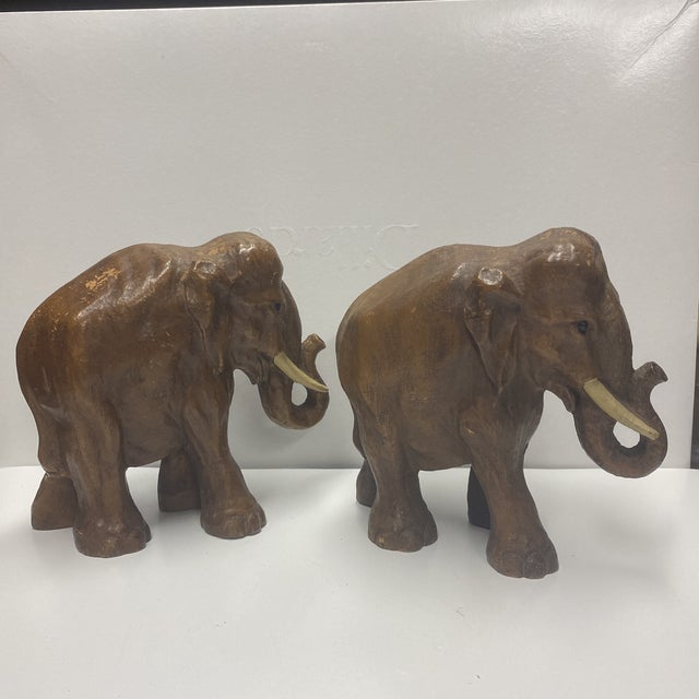 Pair of vintage solid wood carved elephants, natural age shown in pics.