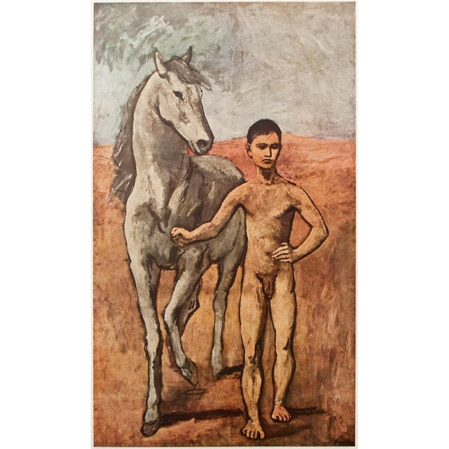 A gorgeous tipped-in original period lithograph after oil painting Boy Leading a Horse (1905) by Pablo Picasso from first...