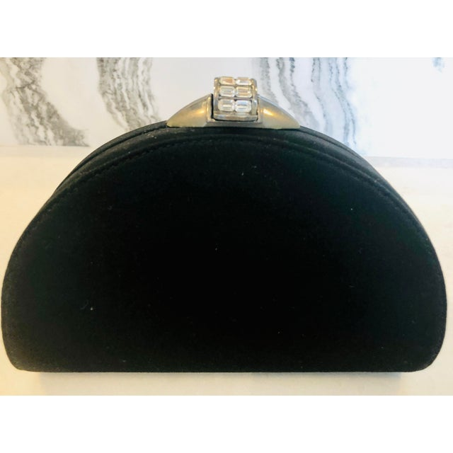 Like new, sleek black silk clutch from Rodo. Made in Italy. Gunmetal toned metal hardware accented with large baguette...