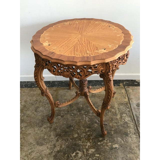 Antique French hand carved round entry table with stunning wood floral inlaid rose pattern. Satinwood, burl wood and...