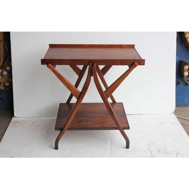 1950's walnut serving table/cart designed by Kipp Stewart for Drexel. This table is from Drexel Declaration line. It has...