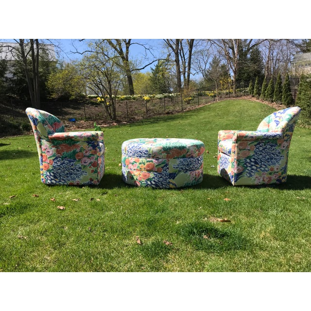 Set of two club chairs and one large round ottoman. Chairs have swivel bases and are very heavy. Tufted backs and ottoman....