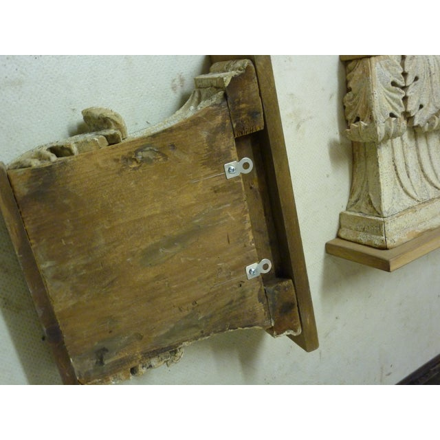 19th Century carved capitals, with original paint, with small, unpainted wood shelf added later, hangers on back for...