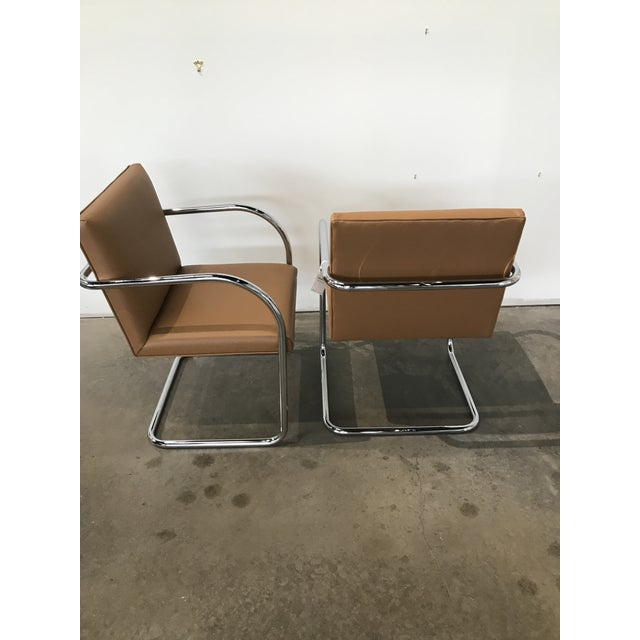 Pair of Bruno Tubular chrome chairs. New upholstery in Knoll Faux Leather. Made in the 1950s.