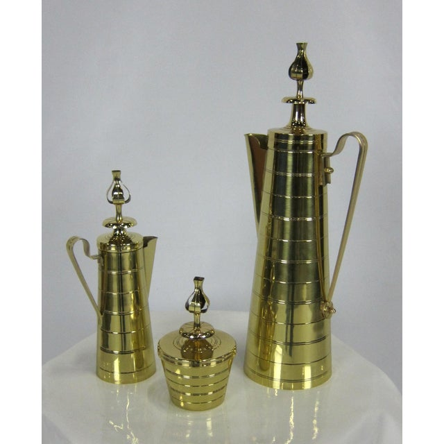 Brass Coffee Service by Tommi Parziger for Dorlyn Brass. The set consists of a tall lidded carafe, creamer, and lidded...