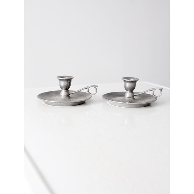 This is a pair of vintage Carson statesmetal chamberstick holders. The pewter style candlestick holders have a classic,...