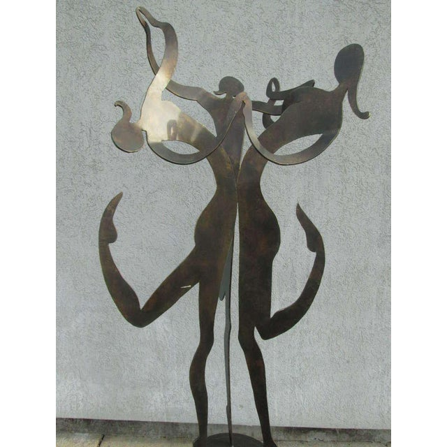"Large female figural sculpture. Sculpture is steel with a bronze finish. Patinated steel. Art Deco Style. Measures: 73.5""H..."