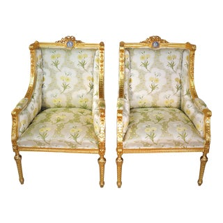 A Pair of Circa 1900 French Louis XVI Style 24k Gilt Armchairs For Sale