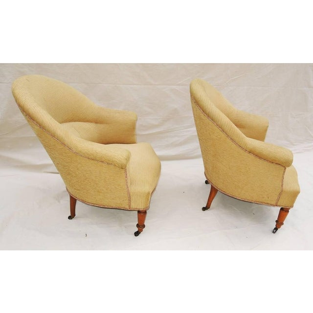 """A solid pair of Napoleon III armchairs covered in pale gold corduroyed velvet, circa 1900. Original wheels. Seat hgt.: 16.5""""."""