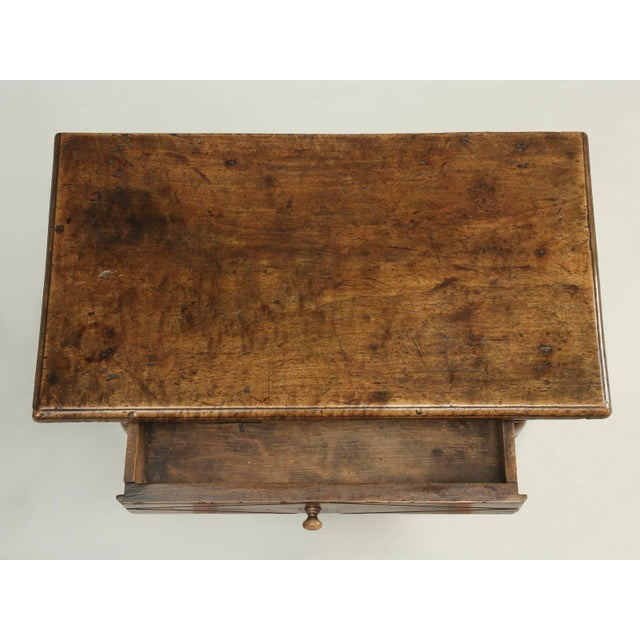 Antique Country French side or end table, dating all the way back to the early 1700s. The top is made from one magnificent...