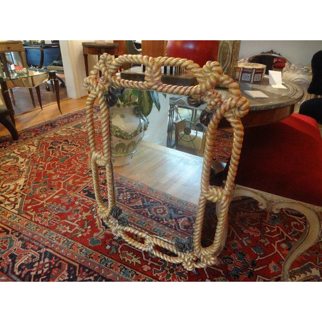 Stunning Italian Hollywood Regency gilt wood mirror with rope and tassel design. This versatile Italian midcentury...