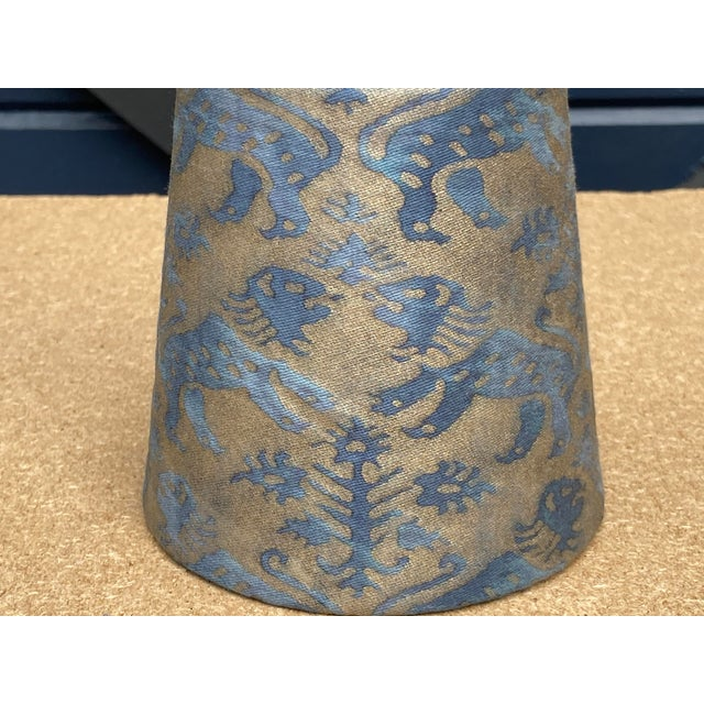 A clip top chandelier shade handmade from an iconic Fortuny printed fabric.